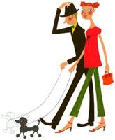 犬の散歩をしているカップル