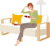 ソファ座って本を読んでいる女性