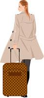 キャリーバッグをひいて歩く女性の後ろ姿