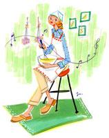 イスに座って料理をする女性