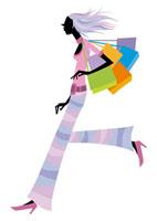 ショッピングバッグを持って走る女性