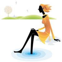 湖の畔に座っている女性
