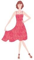 赤いワンピースを着てポーズをとる女性