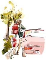 車から降りて荷物を運ぶ女性