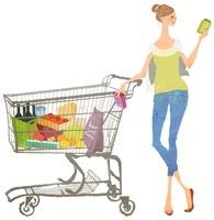 ショッピングカートの横で商品をセレクトしている女性
