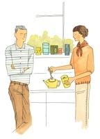 お茶の準備をする夫婦 02463000817| 写真素材・ストックフォト・画像・イラスト素材|アマナイメージズ