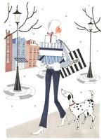 プレゼントを持って犬と歩いている女性 02463000838| 写真素材・ストックフォト・画像・イラスト素材|アマナイメージズ