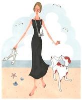 ビーチで犬と遊んでいる女性