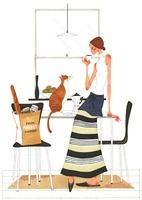 猫と目を合わせたままでコーヒーを飲んでいる女性