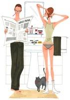 新聞を読んでいる男性と髪の毛をセットする女性