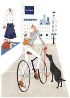 ショーウインドーを見ながら自転車に乗っている女性