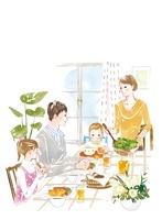 楽しくご飯を食べている家族