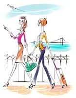 カバンを持って旅行に出かける女性二人