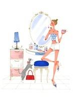 猫と鏡を見ながらメイクをしている女性