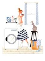 猫とお茶をしている女性
