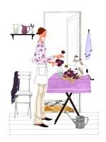 猫とお花を飾っている女性