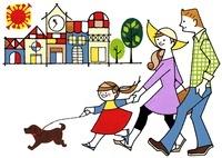 街で犬の散歩をしている家族