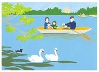 公園の中の小池でボートに乗っている家族