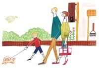 犬の散歩をしている家族