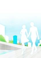 街で手を繋ぎながら歩いているカップル