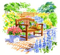色とりどりの花に囲まれたベンチ