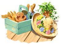 箱に入ったガーデニングの道具と麦わら帽子