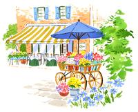 広場に停めてある色とりどりの花が入った小さいカート