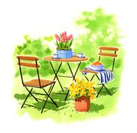 庭にある小さいテーブルとお花