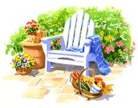 たくさんの草花に囲まれた白い椅子