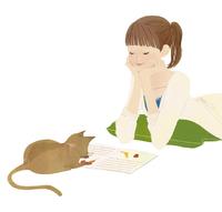 ネコと雑誌を読んでいる女性