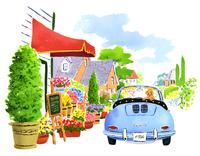 入り口にたくさんお花があるお店と犬が乗っている車