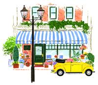 お店と街灯と黄色い車