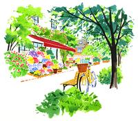 木と花が並んだ道ばたにあるベンチと黄色い自転車