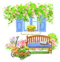 たくさんの草花がある庭とベンチと花が入ったカート