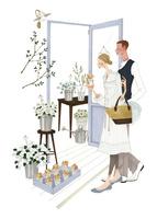 花屋で買い物する男性と女性