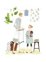 洗濯物を干す女性と子供
