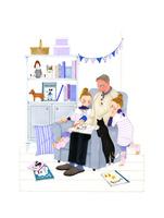 部屋で子供と猫に絵本を読み聞かせる男性