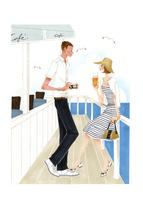 海のそばにあるカフェで話す男性と女性