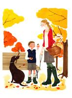 秋の公園で犬の散歩をする女性と犬