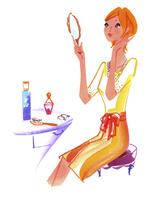 手鏡を持ち化粧をする女性