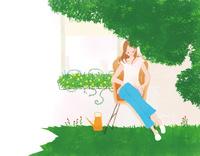 外で読書をする女性