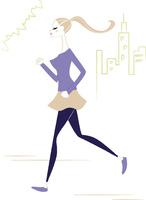 街の公園を走る女性