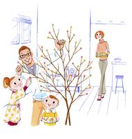 木に飾りを付ける家族