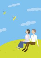 草原に座る夫婦