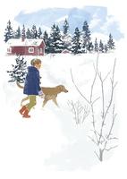 雪の中を歩く男の子と犬