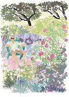 花に囲まれた庭に座る男性