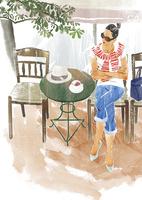 カフェで紅茶を飲む女性