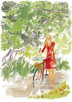 自転車をひいて歩く女性