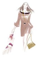 バッグとマフラーを手に持ち歩く女性