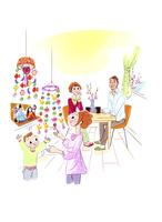 ひな祭りの飾り付けをする家族